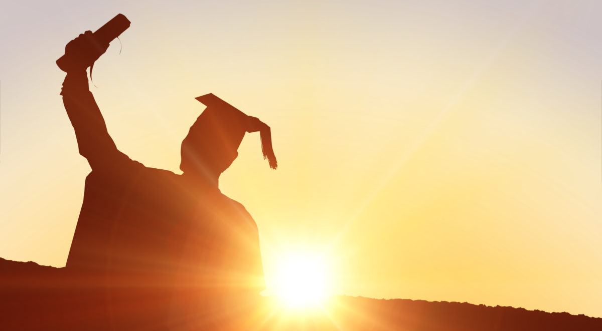 graduate at sunrise